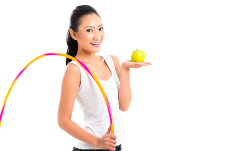 staying in shape: Young Asian woman living healthy and eating fruits