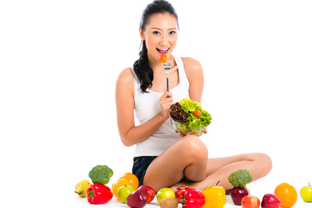 stay beautiful: Asian Chinese woman eating healthy salad