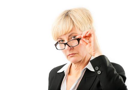 studioshoot: Mature woman looking through her glasses, studio-shoot Stock Photo