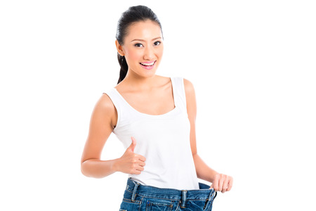 staying in shape: Asian Chinese woman losing weight with diet