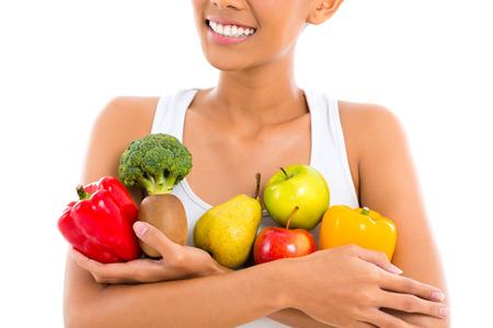 Aziatische vrouw het eten van gezond fruit