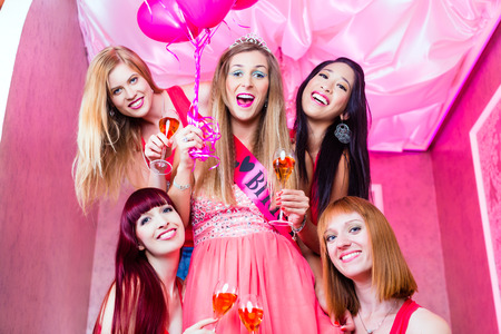 Women having bachelorette party in night club photo