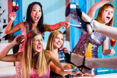 stripper: Friends watching striptease in strip club grabbing at female stripper