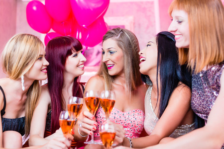 girl friend: Women partying with champagne in night club