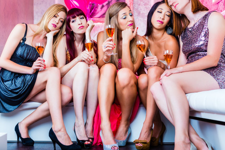 Women partying with champagne in club  until morning rise