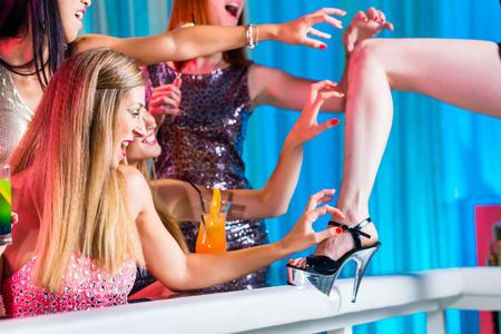strip club: Drunk girls with fancy cocktails in strip club