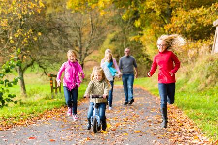 walk in: Family taking walk in autumn fall forest