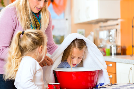 inhale: Mother care for sick child with vapor-bath at domestic kitchen