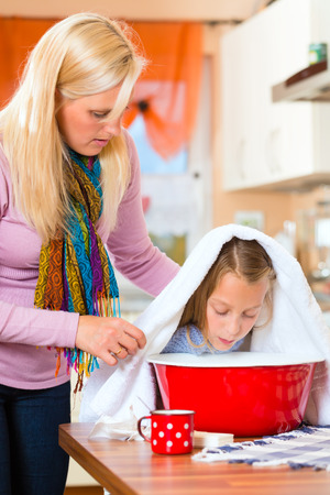 inhale: Mother care for sick child with vapor bath at domestic kitchen