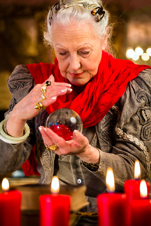 clairvoyance: Female Fortuneteller or esoteric Oracle, sees in the future by looking into their crystal ball Stock Photo