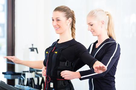 Female coach dress woman in ems electro muscular stimulation costume