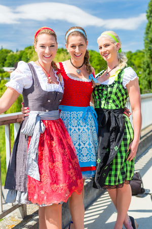 dirndl: Friends visiting together Bavarian fair in national costume or Dirndl Stock Photo