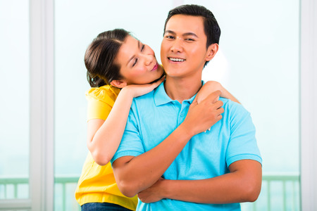 longterm: Young Asian handsome couple in apartment having long-term relationship cuddling together Stock Photo