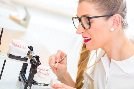 Dental technician producing denture Stock Photo