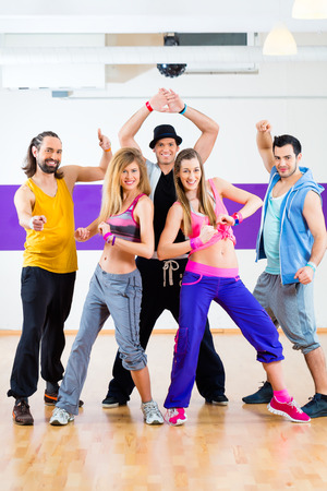 choreography: Group of men and women dancing fitness choreography in dance school