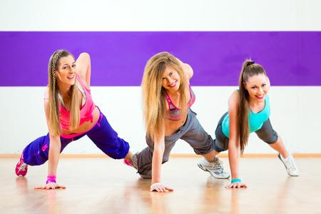 beat women: Young women dancing modern group choreography in dance school Stock Photo