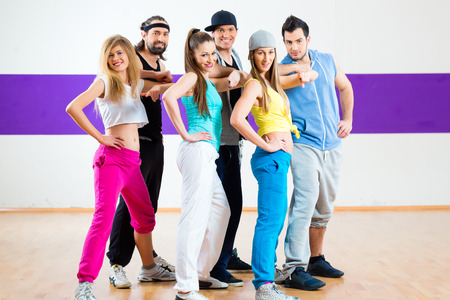 modern dance: Young men and women dancing modern group choreography in dance school