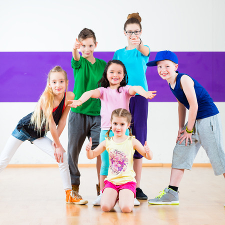 hip hop dancing: Children in class dancing modern group choreography