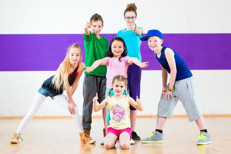 Children in class dancing modern group choreography photo