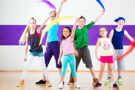 Children dancing modern group choreography with scarfs Imagens