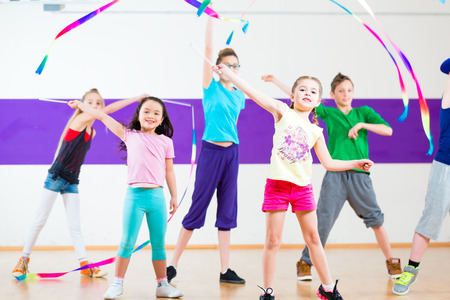 hip hop pose: Children dancing modern group choreography with scarfs Stock Photo