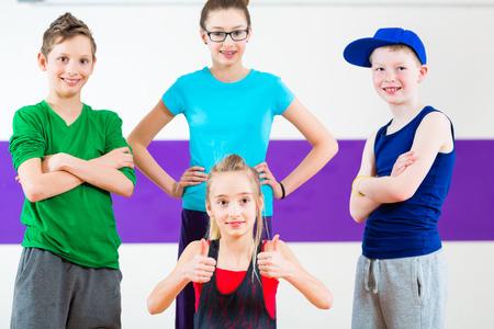 Children dancing modern  group choreography in dance class photo