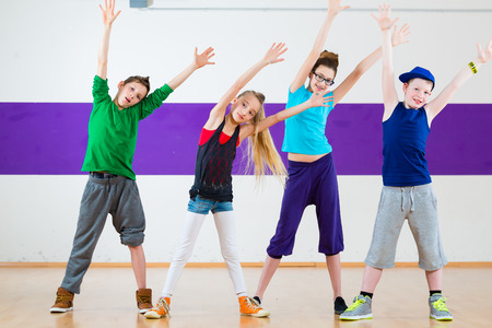 dancing pose: Children dancing modern group choreography in dance class
