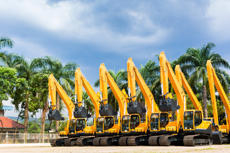 palm lined: Asian Vehicle fleet with construction machinery of building or mining company