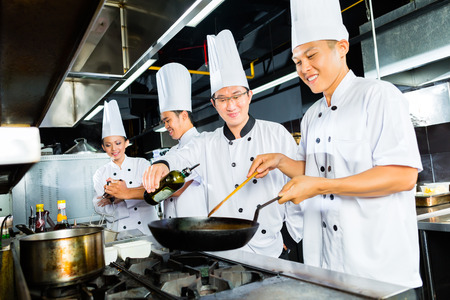 asian chef cooks dish finishing in indonesian Stock Photo