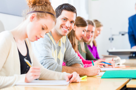 oversee: University college students having examination Stock Photo