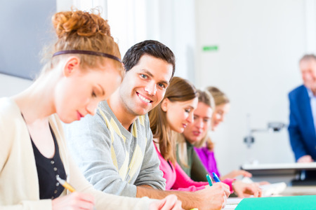 University college students having examination Stock Photo