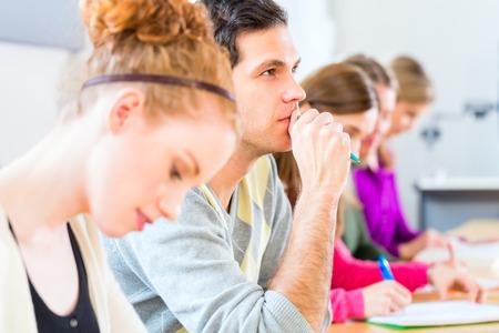 University college students having examination Stock Photo