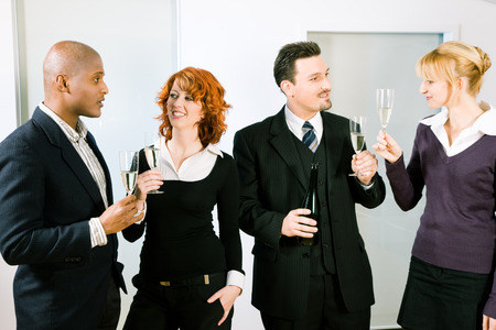 office party: People at a reception at the point where the toast is being given, maybe an office party - people wearing business clothes