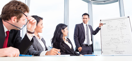 Business team discussing acquisition in meeting photo