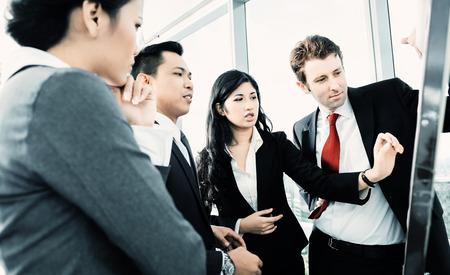 International business team on flipboard Foto de archivo