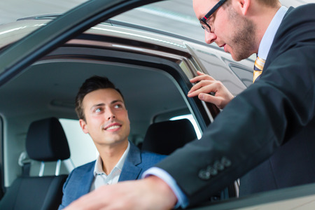 test drive: Customer buying new car in auto dealership