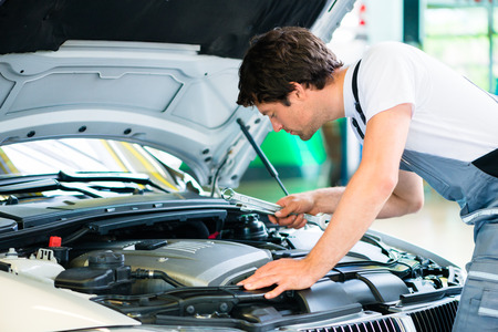service car: Auto mechanic working in car service workshop Stock Photo
