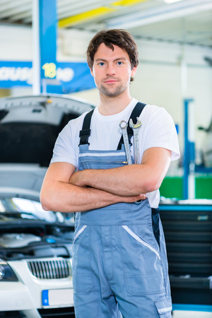 car workshop: Mechanic working in car workshop Stock Photo