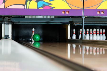 Bowling ball striking last pin