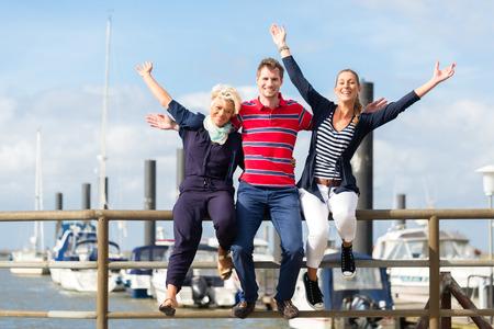 Friends enjoying vacation at German north sea ship pier photo