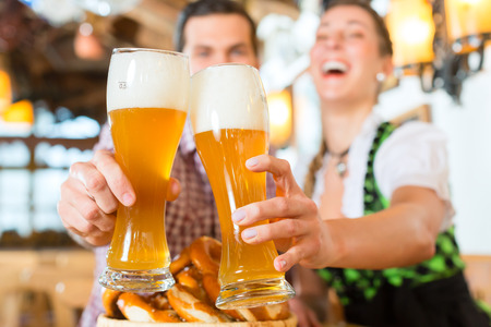 Couple drinking wheat beer in bavarian restaurant photo