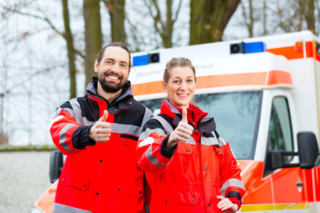 Emergency doctor and nurse standing in front of ambulance Stock Photo