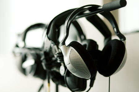 music production: A set of studio headphones hanging on a rack Stock Photo