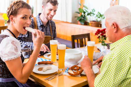 veal sausage: Man and woman eating in bavarian restaurant