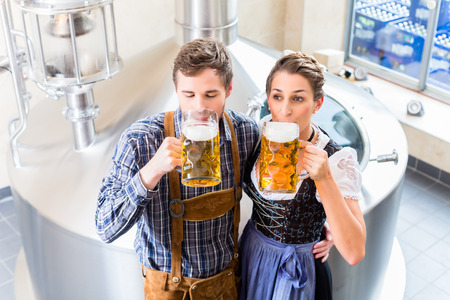 brew house: Brewer and woman toasting in beer brewery