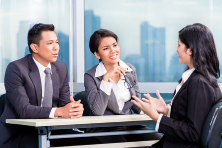Asian recruitment team hiring candidate in job interview Stock Photo
