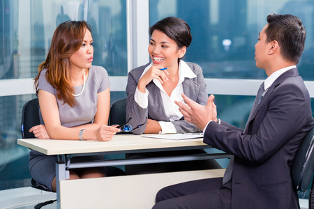 southeast asian: Asian recruitment team hiring candidate in job interview Stock Photo