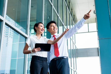 two visions: Chinese business man explaining his vision or idea to colleague Stock Photo