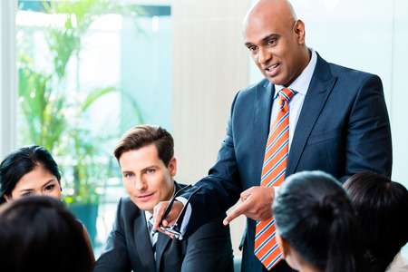 team leader: Indian Business man leading team meeting of diversity people in office