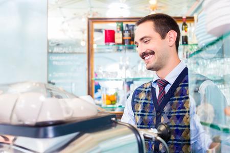 espresso machine: Barista preparing coffee in cafe bar using professional espresso machine